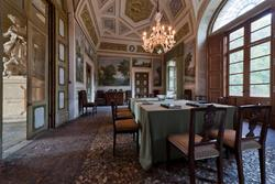 Dining room in venetian villa with statue