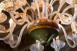 veentian villas in verona, the detail of the decors of a chandelier