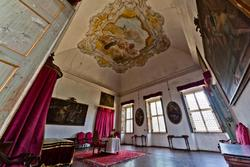 one of the bedrooms internal of the ventian villa, the red chamber