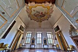 Decorated ceiling and windows of one of the salon fn the eighteenth-century villa in Verona