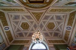 decorated ceiling and chandelier in the dining room of the eighteenth-century villa in Veneto